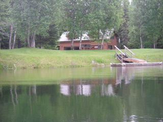 Bigfork cabin photo - tranquil view from the kayak on the Swan River