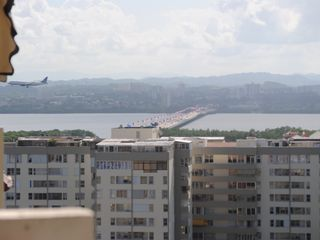 Isla Verde apartment photo - The view from the balcony, to the left. You can see the Teodoro Moscoso Bridge.