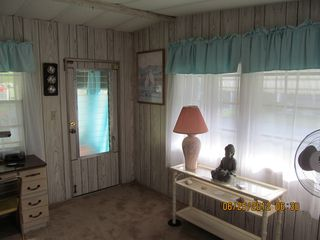 New Port Richey mobile home photo - Florida Room leading to Front Screened Porch