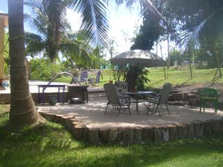 Bacalar house photo - New patio off of Yvon's studio where campfire and guitar get-togethers are held.