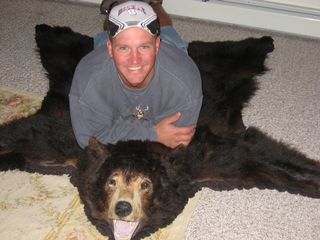 Bretton Woods house photo - One of our workers tries out the bear skin rug !
