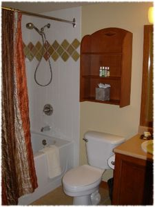Private bathroom in bedroom suite with full size tub and shower.