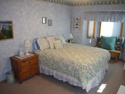 Bedroom with queen bed and bay window seating area