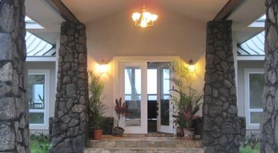 Front entry to home with view of living room and ocean