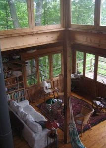 living room of main cottage, post and beam construction. Two couches there now