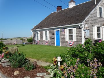 West Yarmouth house rental - front of house with beautifully landscaped yard