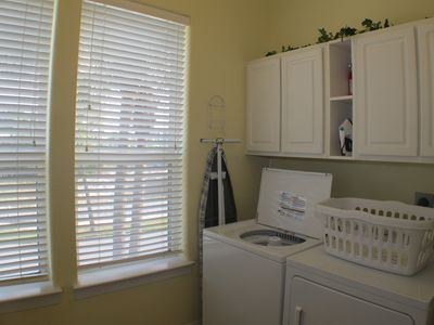 Full size laundry room with washer and dryer