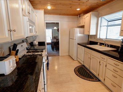 Kitchen with granite counter-tops and full amenities.