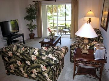 "Living room with 42"" flat screen tv, screened-in patio and comfortable furniture"