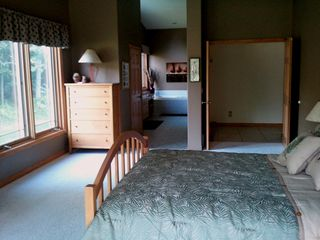 Master Bedroom and Bath - Pentwater house vacation rental photo