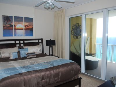 Enjoy the sun sparkles in emerald waters right from your luxurious master suite