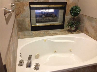 newly tiled ensuite with jacuzzi: fireplace is decorative only