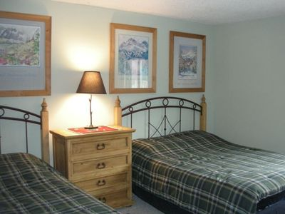 The second bedroom has two queen size beds.