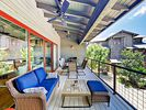 Balcony - Relax on the covered balcony, furnished with an outdoor love seat, coffee table, and ottoman.