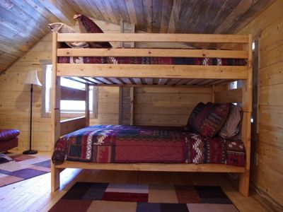The bunk bed has two full mattresses.