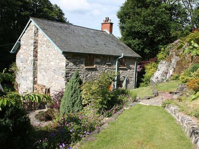 Idyllic Detached Stone Cottage With Log Burner And Beams Set In Private Gardens.