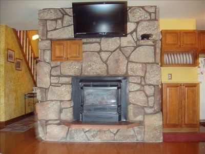 Gas fireplace, large screen TV, and surround sound makes this condo cozy.