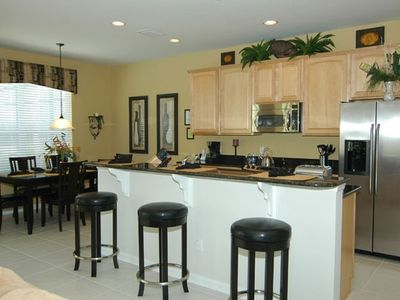 Granite counters, 4 stainless appliances, maple cabinetry, recessed lighting