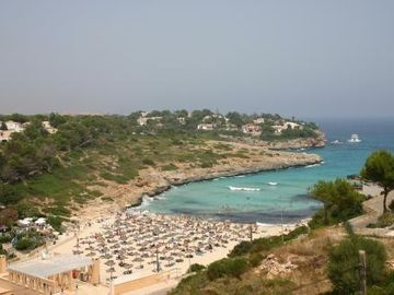 Cala Mandia beach from the rooftop terrace
