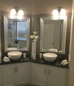 Master bathroom - His and Her vessel sinks with granite countertops