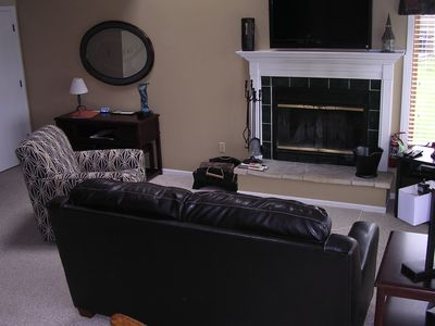Newly Furnished Family Room with Flat Panel TV and Fireplace