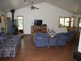 Lake Almanor house photo - Living room, dining room, and kitchen are all open.