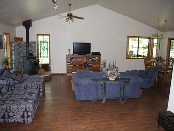 Living room, dining room, and kitchen are all open.