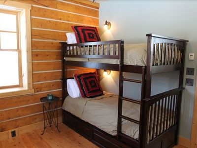 Kid's Bunkroom includes trundle bed, wall mounted TV/DVD, and dresser