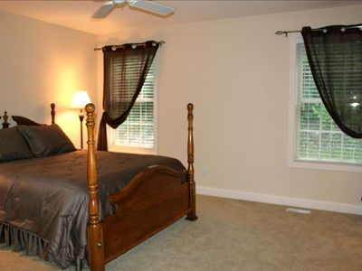 The master bedroom with queen bed is on main floor