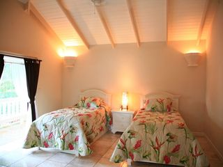 Marigot Bay villa photo - Ginger lily covered beds in guest bedroom 2