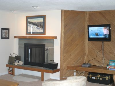 Living Room w wood burning fireplace and flat screen TV