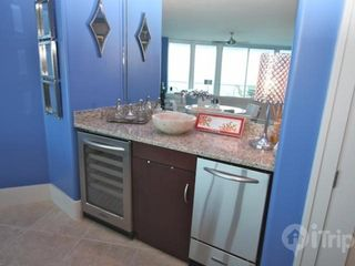Orange Beach condo photo - Wet bar with ice maker and wine cooler