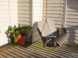 My favorite place! The porch swing on the lower deck.