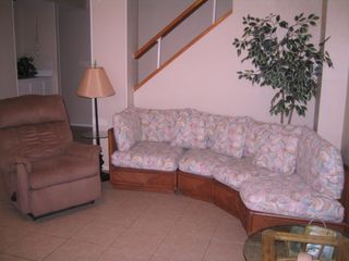 South Padre Island condo photo - Living room with 2 recliners for your comfort. Wet bar and stairs to bedrooms.