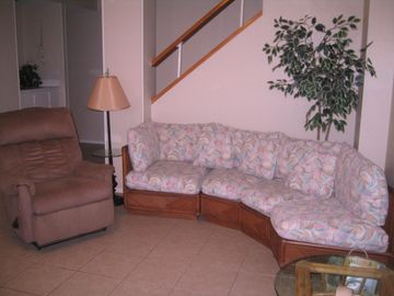 Living room with 2 recliners for your comfort. Wet bar and stairs to bedrooms.