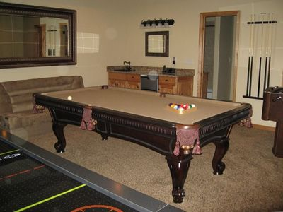 Game room with pool table, air hockey, foosball, games and more!!