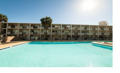 Steps Away to outdoor & indoor Pools and Across the Street from the Beach