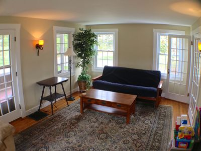 The large living rm. has french doors for privacy and 2 queen size guest beds.