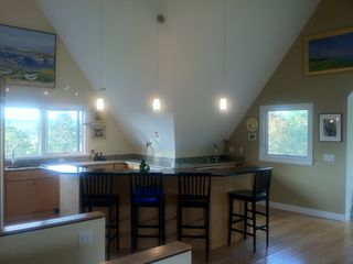 Wellfleet house photo - Light and airy kitchen with large center island, two sinks and 6 burner stove