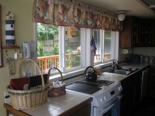Camano Island house photo - Galley style kitchen with a view.