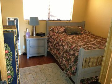 Queen sized bed with lots of light and beautiful southwestern furnishings.