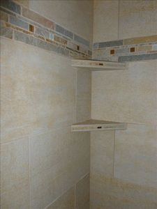 Close-up of custom built shelves in upstairs shower
