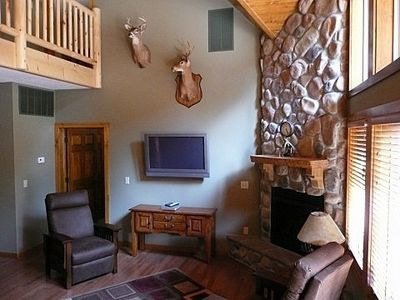 Main level stone fireplace adds to coziness of great room