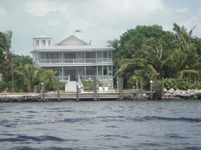 Stunning three story home with deep water dockage