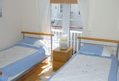 Twin Bedroom 3 with rear balcony