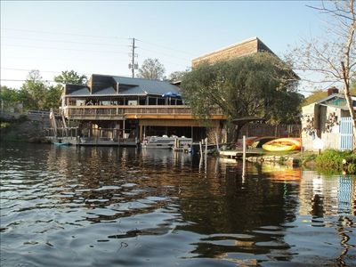 upper deck's waterfront dinning and boat rental away, across from beach.
