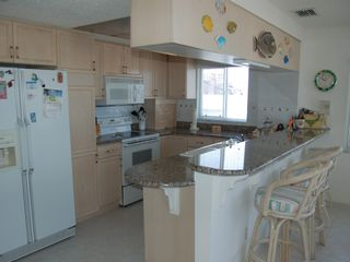 Redington Shores condo photo - Kitchen-dishwasher, trash compactor ,granite counters
