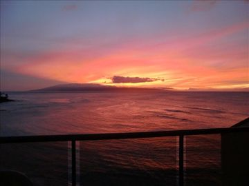 Kahana condo rental - Looking out at the island of Lana'i at sunset from the penthouse's main floor.