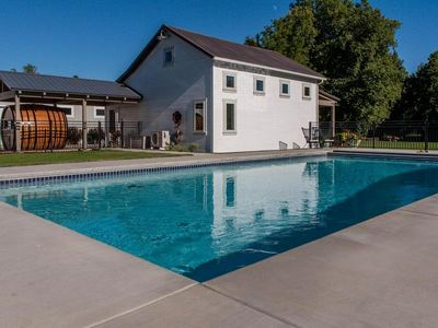 Bryant Barn sits on the edge of a beautiful pool, reserve now for next summer.