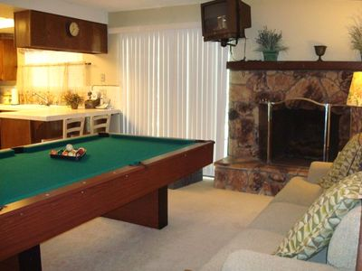 8' pool table for tournaments and sports TV above